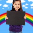 A Smiling Girl Holding A Blank Black Board — Stock Photo