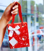 A Gift Wrapped Bag Being Held Up — Stock Photo