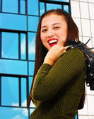 Attractive Young Woman Standing In Front of a Building — Stock Photo
