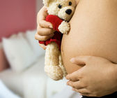 Mom With Teddy Expecting A Baby — Stock Photo