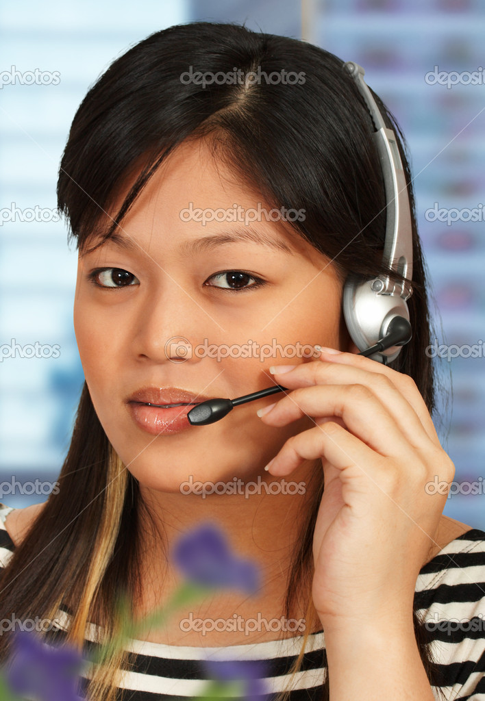 Hotline assistant talking to a customer on the phone — Stock Photo #5847644