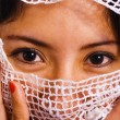 Muslim Woman With A Veil Over Her Face - Stock Photo