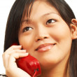 Foto Stock: WomTalking On Landline Phone