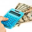 Calculating Expenses On Calculator — Stock Photo #6414139