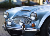 A classic shiny metallic blue sports car — Stock Photo