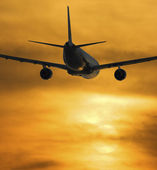 Airplane Flying Towards The Sunset — Stock Photo