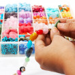 Stock Photo: Choosing Beads For Unique Necklace