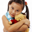 Teddy Bear Being Hugged By A Young Girl — Stock Photo