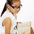 Small Girl Reading A Text Book — Stock Photo
