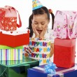 Girl Receiving Many Birthday Gifts — Stock Photo #6439755