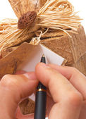 Writing A Message On A Gift Tag — Stock Photo