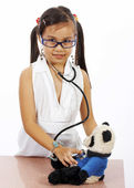 Girl Doctor Checking The Health Of Her Teddy — Stock Photo