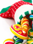 Candies In A Christmas Sock — Stock Photo