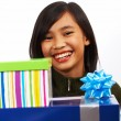 Girl Happy With Her Birthday Gifts — Stock Photo #6440358