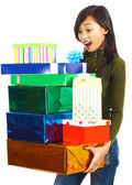 Girl Receiving Stack Of Gifts — Stock Photo