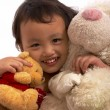 Stock Photo: Little Girl Cuddling Soft Toys