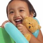 Happy Kid Holding A Teddy Bear — Stock Photo #6490642
