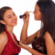 Girl Giving Her Friend A Make Over - Stock Photo