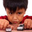 Boy Playing With Toy Cars On A Table — Stock Photo
