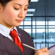 Airport Staff Making Notes - Stock Photo