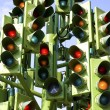 Stock Photo: Confusing Traffic Signals At Busy Intersection