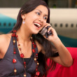 Girl On A Mobile Phone At The Airport — Stock Photo
