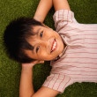 Asian Boy Relaxing On The Lawn — Stock Photo