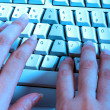 Royalty-Free Stock Photo: Typist At Work At Her Computer