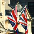 Stock Photo: British Union Jacks Outside A Building In England