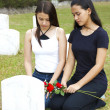 Stock Photo: Two Sad Girls At A Grave