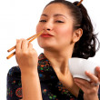 Japanese Girl Eating With Chop Sticks — Stock Photo