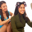 Girl Putting Her Hair In Rollers — Stock Photo #6494940