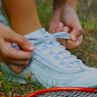 Tying Shoes Ready For A Game Of Badminton — Stock Photo