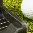 Stock Photo: Putting Golf Ball On Putting Green