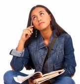 若い学生の彼女の研究を考える — ストック写真