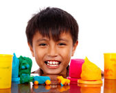 Happy Boy Playing With Colored Dough — Stock Photo