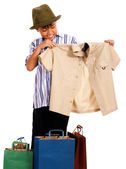 Boy Looking At Bought Clothes — Stock Photo
