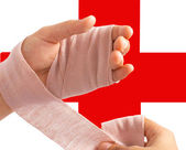 Wrapping A Bandage Around The Hand — Stock Photo