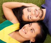 Boyfriend And Girlfriend Relaxing In The Park — Stock Photo