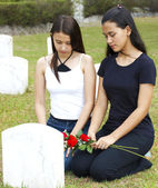Two Sad Girls At A Grave — Stock Photo