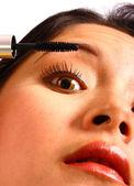 Applying Mascara As Part Of Her Makeup — Stock Photo