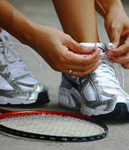 Tying Shoe Laces Ready For A Game Of Badminton — Stock Photo