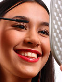 Happy Young Teenager Making Herself Up With Mascara — Stockfoto