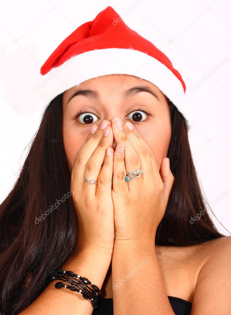 Girl Wearing A Santa Hat Surprised And Excited At Christmas — Stock Photo #6496978