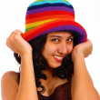 Attractive Teenager Smiling And Holding Her Hat - Stock Photo
