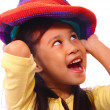 Stok fotoğraf: Smiling And Happy Girl Putting On Hat