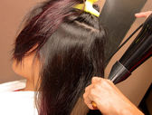 Stylist Using A Hair Dryer To Dry Hair — Stock Photo