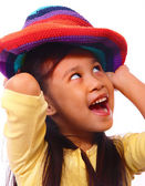 Smiling And Happy Girl Putting On A Hat — Stock Photo