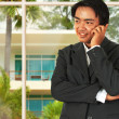 Asian Business Man Talking On The Phone In His Home — Stock Photo