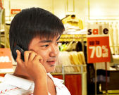 Young Man On The Phone In Front Of A Store — Stock Photo